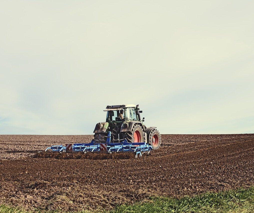 Farmer Using Agricultural Machine