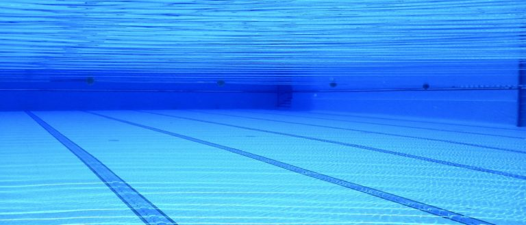 An underwater view of a swimming pool.