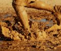A runner going through mud.